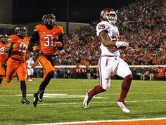 Oklahoma's Joe Mixon (25) leaves behind Oklahoma State's Tre Flowers (31) and Seth Jacobs (10) as Mixon scores a touchdown in the second quarter during the Bedlam college football game between the Oklahoma State Cowboys (OSU) and the University of Oklahoma Sooners (OU) at Boone Pickens Stadium in Stillwater, Okla., Saturday, Nov. 28, 2015. Photo by Nate Billings, The Oklahoman