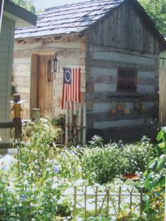 I LOVE this country primitive garden and the log cabin garden shed is perfect!