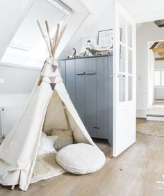 This natural canvas tepee is a great way to add some character and crawl space for your little one!