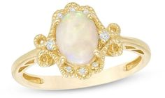 Zales Oval Opal and 1/20 CT. T.W. Diamond Filigree Vintage-Style Ring in 14K Gold