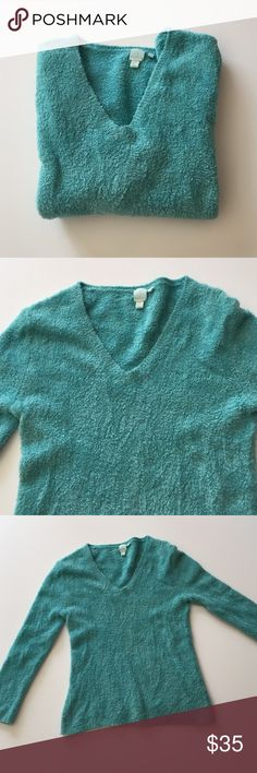 """Shu Shu Aqua Sweater Excellent condition. One of the softest, squishiest sweaters I've ever found. V neck, 3/4 sleeves. Lots of stretch. 68% rayon, 30% tactel, 2% spandex. Hand wash. 16"""" from armpit to armpit. 19"""" long. Not from a smoke free house. Shu Shu Sweaters V-Necks"""