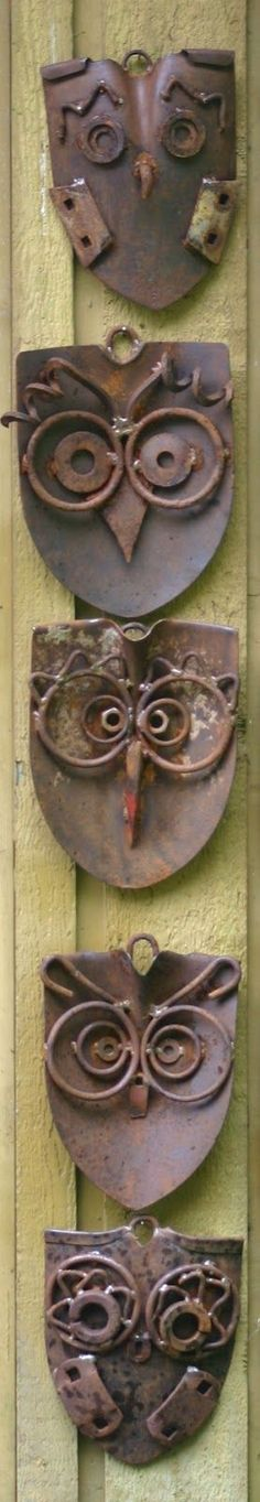 A parliament of junk art owls made from old shovels and other gadgets.