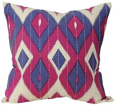 A diamond ikat pillow in fun colors will pop on a neutral sofa. HomeDecorators.com
