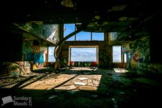 Abandoned hospital entrance with view over the mountains