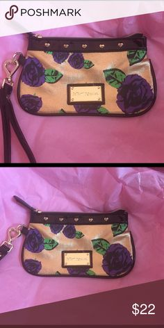 Betsey Johnson Wristlet - Purple Roses and Hearts Betsey Johnson Wristlet - Purple Roses and Hearts along the top and the clip for the strap is a gold heart engraved with Betsey Johnson. NWOT Betsey Johnson Bags Clutches & Wristlets