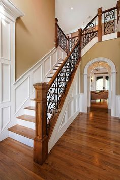 Traditional two story entry foyer with staircase and custom oak and wrought iron. Traditional two story entry foyer with staircase and custom oak and wrought iron railing. Wrought Iron Staircase, Staircase Remodel, Staircase Railings, Staircase Design, Stairways, Banisters, Metal Balusters, Iron Spindles, White Staircase