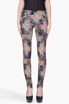 ALICE + OLIVIA //  SKINNY MULTICOLOR FLORAL JEANS  22026F085001    Skinny fit stretch jeans in multicolor. Floral print throughout. Five pocket styling. Silver tone rivets. Tone on tone stitching. Zip fly. 97% cotton, 3% spandex. Dry clean. Made in United States.  $200.00 USD   SIZE GUIDE  ADD TO BAG