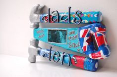 DIY decorated papier mache hammer and saw.  Dad's Den sign.  Decoupaged shapes using Decopatch paper.  Letters are stuck on. #FathersDay #GiftsForDad