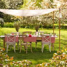Now here's an idea to steal.  Using fabric, bamboo poles and twine create a canopy to dine or recline under.  A fabric canopy can add sophistication as above or whimsy as below.  And of course offers an extra layer of sun protection.