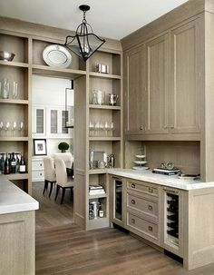 floor to ceiling open storage butlers pantry.... love the pendant light too.