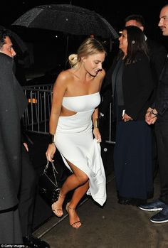 No change: Margot Robbie forwent the standard costume change, instead opting to wear her stunning white strapless dress as she was seen heading into the event's after party at The Standard High Line