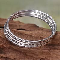 Discover unique handcrafted treasures. Every purchase will help UNICEF save and improve children's lives and help support talented artisans. Sterling silver bangle bracelets, 'Moon Silver' (set of 3)