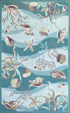 Soft waves of green-aqua splashed with shell and coral images create a lovely pattern in this beach cottage styled Seafoam Waves of Shells Hooked Area Rug.