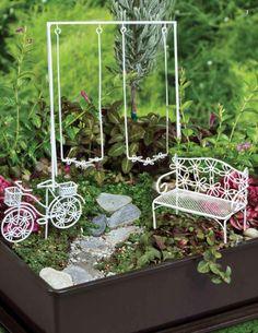 Fairy garden elements - love the flower motif in the wire.