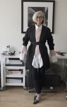 Wearing Brooks Brothers French cuff shirt, Corinne Collection pink sweater, Yohji Yamamoto belted long jacket, Prada mules, Monies earrings and Anne & Valentin eyeglasses