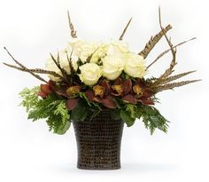 It will take some imagination to picture it with red roses, no orchids, and most likely different greens, but here's some roses and brown feathers for you. Description from pinterest.com. I searched for this on bing.com/images