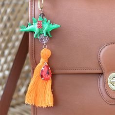 I made these cute and quirky tassel bag charms for about 1/5 of their designer cost. Rawr!