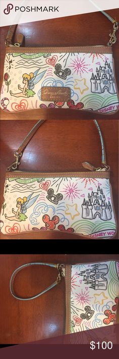 Disney dooney and Bourke sketch purse Dooney & Bourke Disney sketch wristlet small purse. Handle can switch to be made into either. Handle does have some cracking in color as shown. Purse is in very good used condition. Pet smoke free home! Pictures in purse are perfect. Displaying castle and tinker bell. And beauty and the beast rose. Will mail same or next day! Dooney & Bourke Bags Clutches & Wristlets