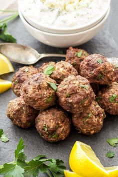 Greek Meatballs with Tzatziki Sauce, perfect for dinner or an appetizer! Full of spices, lemon zest & feta cheese, they'e sure to please Greek food lovers!