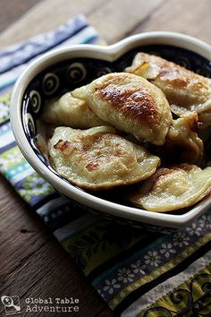 Cheese & Potato Pierogi from Global Table Adventure.  Love this site.  She is cooking food from every country around the world - one cuisine a week.  I made these Polish delicacies with my friend, Laura, and they are really good.  I like this recipe for a smaller batch.  Make EXTRA carmelized onions and add them along with sour cream to the final product!  Yum!