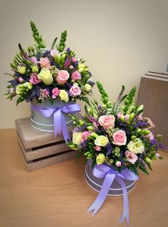 A beautiful selection of fresh flowers in Pinks, Lilac and Cream presented in a ribbon adorned hatbox. A fabulous gift for any occasion. Large hatbox from Flower Bouquet Boxes, Hat Box Flowers, Basket Flower Arrangements, Flower Box Gift, Flower Arrangement Designs, Funeral Flower Arrangements, Beautiful Flower Arrangements, Flower Centerpieces, Fresh Flowers