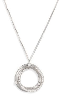 """'Goa' Coil Diamond Pendant Necklace Diamonds dot and pave a trio of nestled rings in a lovely white-gold necklace hand-engraved by Italian Artisans. Lobster clasp closure.  Approx. length: 16 1/2"""". Total Diamond weight: 0.29ct.  Colour: G.  Clarity: VS1.  Diamonds/18k White Gold.  By Marco Bicego; Made in Italy."""