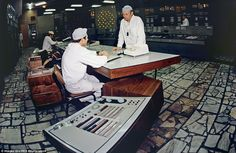 Two workers sit at the control desk of the Chernobyl Nuclear Power Plant near Pripyat