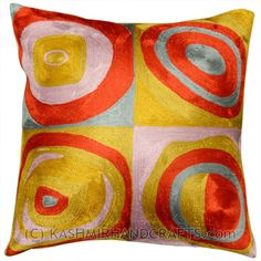 "KANDINSKY-QUADRATE-II-COLORS-SILK-ACCENT-PILLOW-COVER Kandinsky believed that art could visually express music, and is credited for painting the first modern abstractions.In ""Farbstudie Quadrate,"" color and rhythm make beautiful music together and the artisans of Kashmir have crafted this beautiful decorative pillow cover from this abstraction. This cover could grace the cabin of your boat or the chair in your solarium and yet be equally as comfortable in your den."
