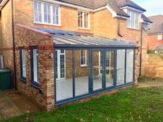Bespoke modern grey aluminium lean to conservatory with brick side walls Conservatory Flooring, Lean To Conservatory, Conservatory Design, Brick Extension, Conservatory Extension, House Extension Design, Extension Ideas, Garden Room Extensions, House Extensions