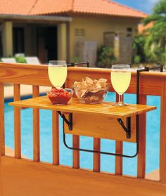 A Folding Deck Table instantly gives you additional room for outdoor serving and more. This attractive wood table comes with metal clamps and brackets that easily secure it to a porch or deck railing. Great for outdoor entertaining, the folding table Porch Table, Deck Table, Porch And Balcony, Balcony Railing, Deck Railings, Table Tray, Patio Tables, Wood Tables, Table 19