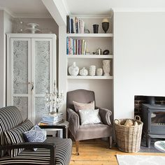 Modern white living room with personalised cupboard | Living room decorating | Style at Home | Housetohome.co.uk