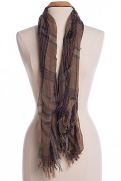 See that cute fall outfit through by completing it with this flannel-inspired beauty! The colors are gorgeous and we love what a cute scarf can add to any class.