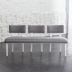 Entry way bench? Love the single base and three seperate seat backs :) Como Bench    Crate and Barrel