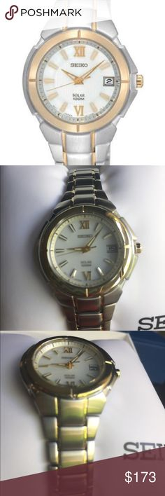Seiko Women's Solar Watch Stunning Solar Two Tone Stainless Steel Silver with Gold Accents. Brushed and polished link bracelet with push button deployment clasp. Stunningly designed gold tone dial with luminous hands and hour markers. Nicely crafted scratch resistant Hardlex crystal. Water resistant. Perfect accessory to add a touch of sophistication. Seiko Accessories Watches