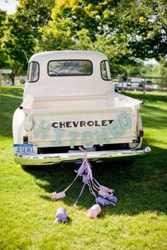 Paper mache block letters were painted and strung up on an old Chevy truck at this fun fête! | via Style Me Pretty