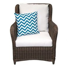 """Indoor/outdoor woven arm chair with Sunbrella cushions.   Product: Club chairConstruction Material: Polyethelene, powder coated aluminum and SunbrellaColor: ChocolateDimensions: 36"""" H x 29"""" W x 34"""" DNote: Accent pillow not includedCleaning and Care: Frame can be cleaned with a mild detergent and water. Upholstery can be machine washed and air dried."""
