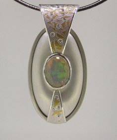 Kombu, silver and 24ct gold with diamonds and Opal pendant