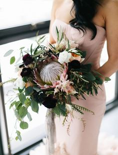 modern and moody blush marsala king protea bouquet with eucalyptus