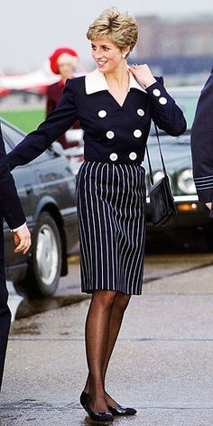 Always appropriate for the occasion, the Princess of Wales gave a nod to naval chic in her double-breasted jacket at the Royal Air Force station in Scampton in 1991.