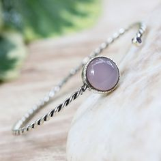 Round pink chalcedony and tiny faceted moonstone gemstones cuff bracelet with sterling silver twist band