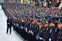 Police Officers gather for the funeral of New York Police Department Officer Wenjian Liu at Aievoli Funeral Home.