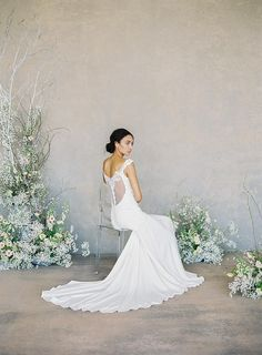Claire Pettibone's 'The White Album' - Angel: A romantic, airy wedding dress with an illusion lace back and slit in the front - Perfect for a beach wedding! Top Wedding Dresses, Gorgeous Wedding Dress, Colored Wedding Dresses, Wedding Colors, Claire Pettibone, Bride Groom Table, White Lace Gown, Brides Room, The White Album