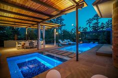 2 Beauty Bower Pl The Woodlands, TX 77382: Photo In-ground Gunite Pool, Glass tile and plaster finish, natural stone pavers and composite wood decking
