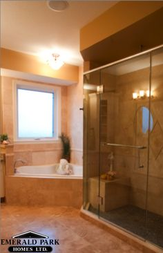 Spa like master ensuite with a corner soaker tub and a glass shower
