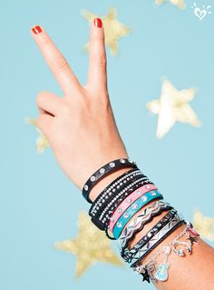 Wrist on a star! Rock out with stackable bracelets that pack a whole lot of charm!