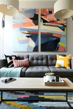 coordinating abstract art, rug and throw pillows