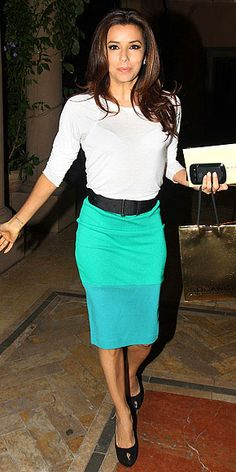 Eva Longoria in green-and-blue skirt, a sheer white top and peep-toes.
