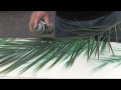 Quick Surfboard Painting for Gerry Lopez Quick using Palm leaf and spray paint!