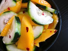 Cucumber mango salad from budget bytes. made this last night and it was so yummy and fresh with a few adjustments- halved grape tomatoes, a couple dashes of soy sauce, extra red pepper flakes, and less sugar. Thai Cucumber Salad, Mango Salad, Vegetarian Recipes, Cooking Recipes, Healthy Recipes, Cooking Time, Healthy Foods, Fruits And Veggies, Vegetables