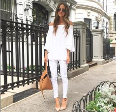 Arielle Noa Charnes of @somethingnavy in a white top, white jeans, nude heels, and tan bag
